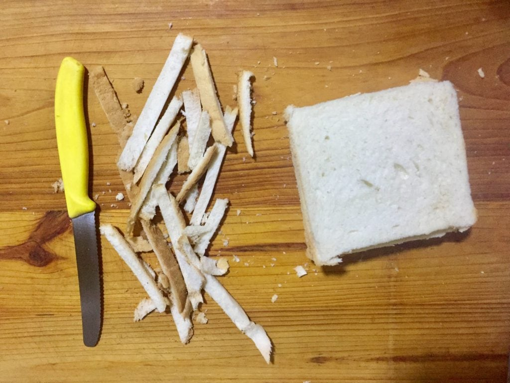 Trim sides of bread.